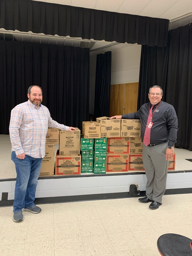 Pastor John making delivers food to Mr. Allen for WMS's food backpack program