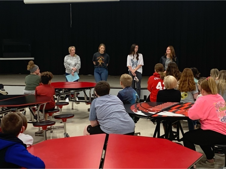WHS student council members visit with WMS students
